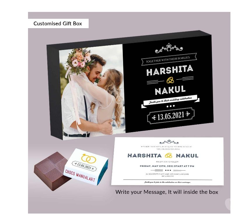 Wedding planners New Delhi - Photos for Delicate wedding rings printed wrapped chocolates invitation